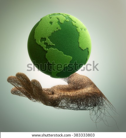 hand made of branches holding a green earth
