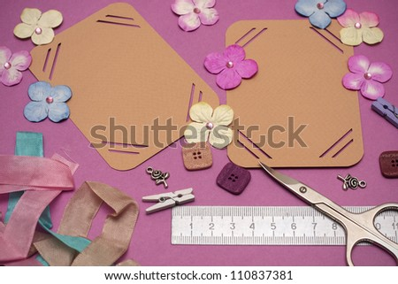hand made scrapbooking album and tools lying on a table