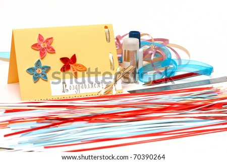 hand made scrapbooking post card and tools on a white background close-up