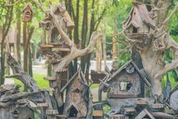 Hand made wooden bird house nest  in public Park , hand wood shelter for birds