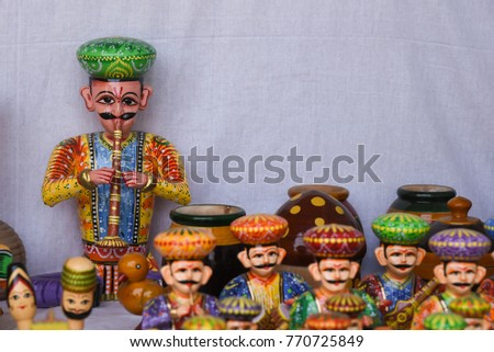 Hand made wooden models of musicians, handicraft Rajasthan India. Dolls men, women face wearing traditional Indian dress Saree or Sari, Kurta for plays, dance, Dilli Haat for Dussehra, Diwali festival