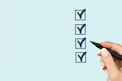 Hand make marking on checklist box, Checklist concept,