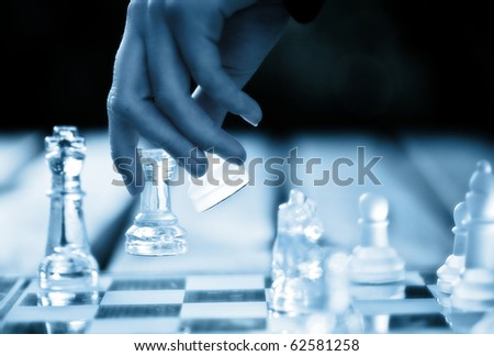 hand making a winning chess move