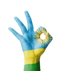 Hand making Ok sign, Rwanda flag painted as symbol of best quality, positivity and success - isolated on white background