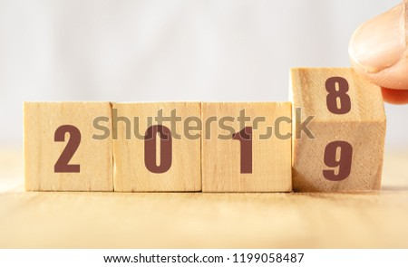 hand man try to open or flip to find the trend new year 2019, happy new year concept #1199058487