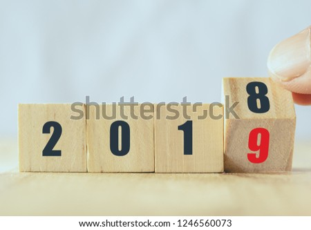 hand man try to open or flip to find the trend new year 2019, happy new year concept #1246560073