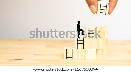 hand man try to put the next stair on the wooden dice to the man for next step ,chance, job ,business,success ,project ,goal