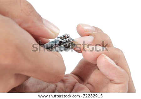 hand manicure with nail clipper. close up over white background