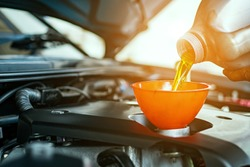 Hand mechanic in repairing car,Change the Oil