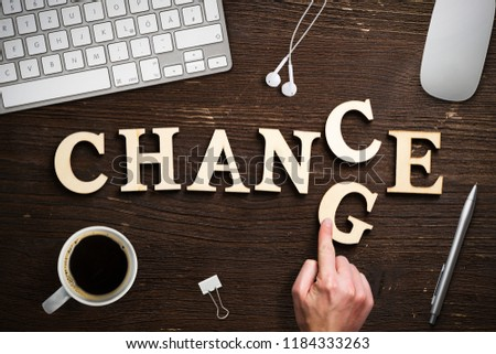 """hand moving a letter, turning the word """"change"""" to """"chance"""" #1184333263"""