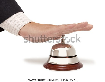 Hand of a businessman using a hotel bell isolated