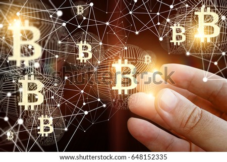 Hand of a businessman with bitcoin in the network.