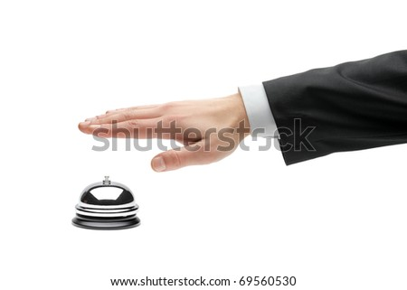 Hand of a businessperson using a hotel bell isolated against white background