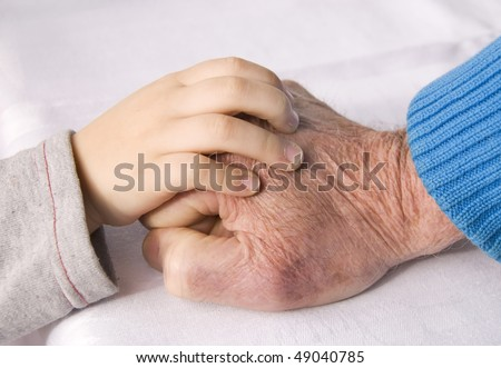 hand of a child and grandfather