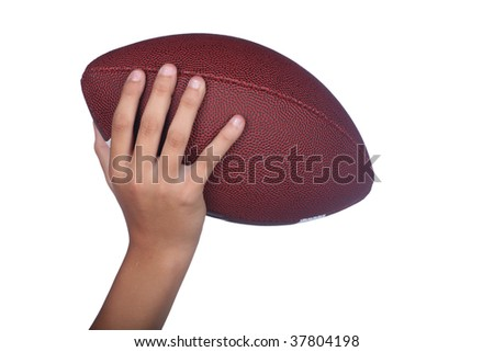 Hand of a child holding or passing an isolated football