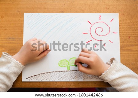 Hand of a child who draws