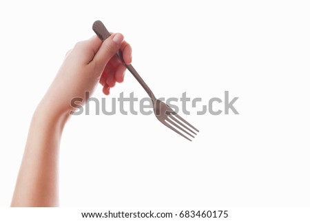 Hand of a girl on an isolated white background with a fork