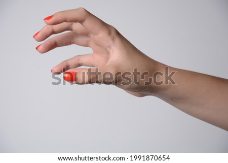 Hand of a girl trying to reach or grab something. Fling, touch sign. Isolated on white background. Stock photo ©