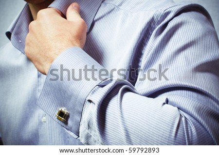 hand of a man in a shirt
