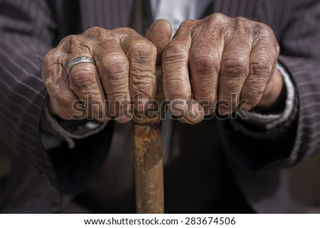 hand of a old man holding a cane #283674506