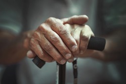Hand of a old man holding a cane. Senior Man Holding Cane. Close-up Of old man Hands On Walking Stick.