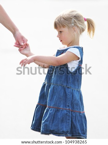 hand of a parent and child - stock photo