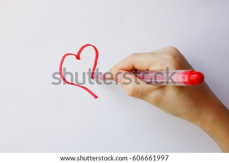 hand of a person drawing a...