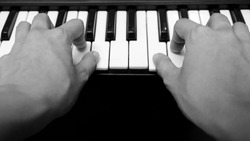HAND OF A PIANIST IN BLACKANDWHITE CONCERT DAY
