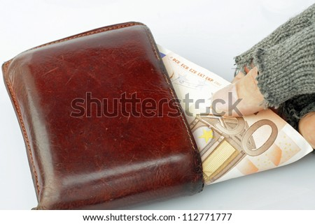 hand of a poor man who steals money from a wallet
