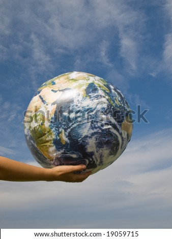 Hand of a woman holding earth