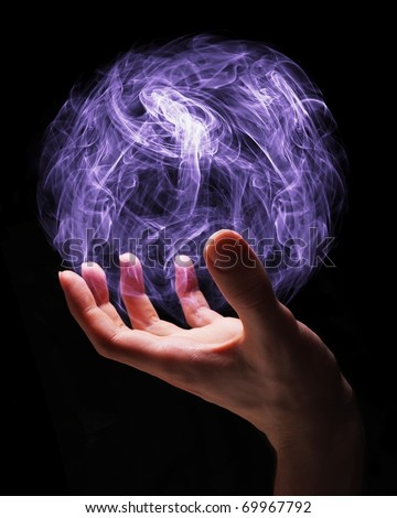 Hand of a young wizard creating a magical sphere.