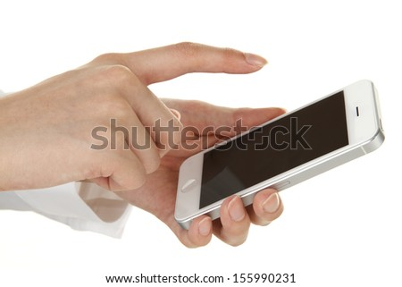 Hand of a young woman using a smartphone