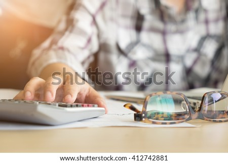 hand of accountant analyzing bussiness and finance and stock report.top view with copy space