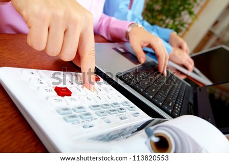 Hand of accountant business woman working with a calculator.