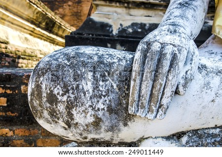 Hand of an ancient Buddha statue #249011449
