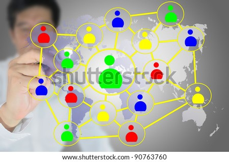Hand of Asian businessman write  social network diagram on tablet screen.