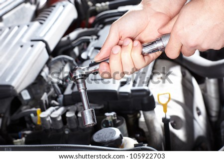 Hand of auto mechanic with a wrench Car repair