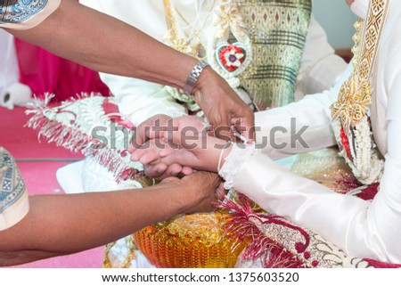 hand of bride and hand of Wedding guests, guests Greeting to groom and bride #1375603520