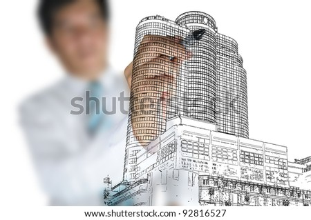 Hand of Business man draw modern building