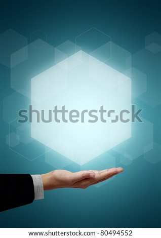 Hand of business man have Hexagon above on green background.