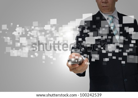 Hand of Business Man Hold touch screen of smartphone sending digital data.