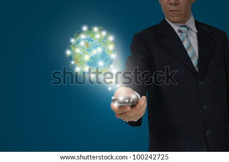 Hand of Business Man Hold touch screen of smartphone sending e-mail to earth globe. Elements of this image furnished by NASA