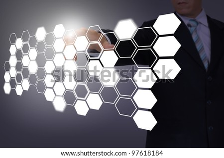 Hand of Business Man Pressing or Pushing hexagon button on touch screen interface