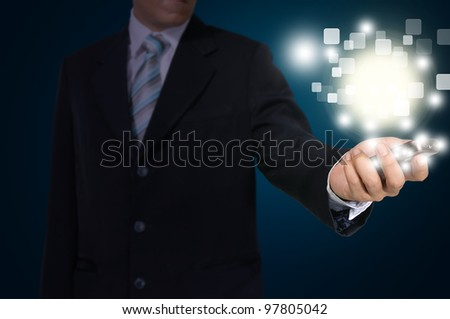 Hand of Business Man Pressing or Pushing touch screen of Mobile Smartphone