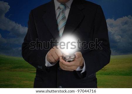 Hand of Business Man Pushing touch screen of mobile smart phone
