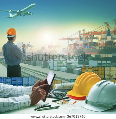 hand of business man working on working table in container dock use for logistic industry and import export , freight cargo shipping industrial
