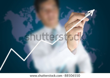 Hand of business man write a 3d business graph on tablet pc touch screen