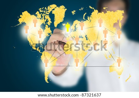 Hand of business man write a social network chart or diagram with world map