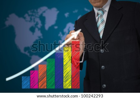 Hand of Business Man write growth graph