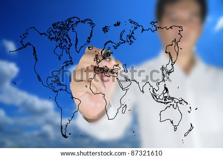 Hand of business man write world map on tablet pc touch screen